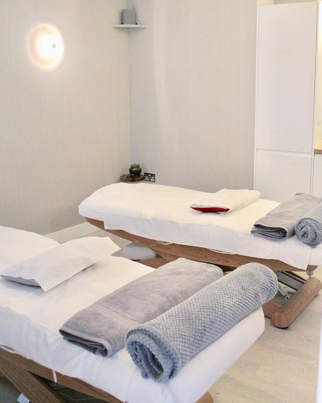 wooden massage bed cosy and clean room