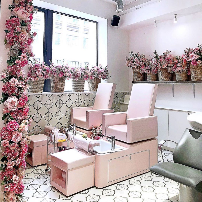 modern art deco pink flower salon with pink chairs