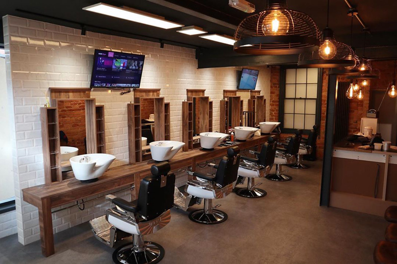 industrial barber shop with tv and white bricks london style