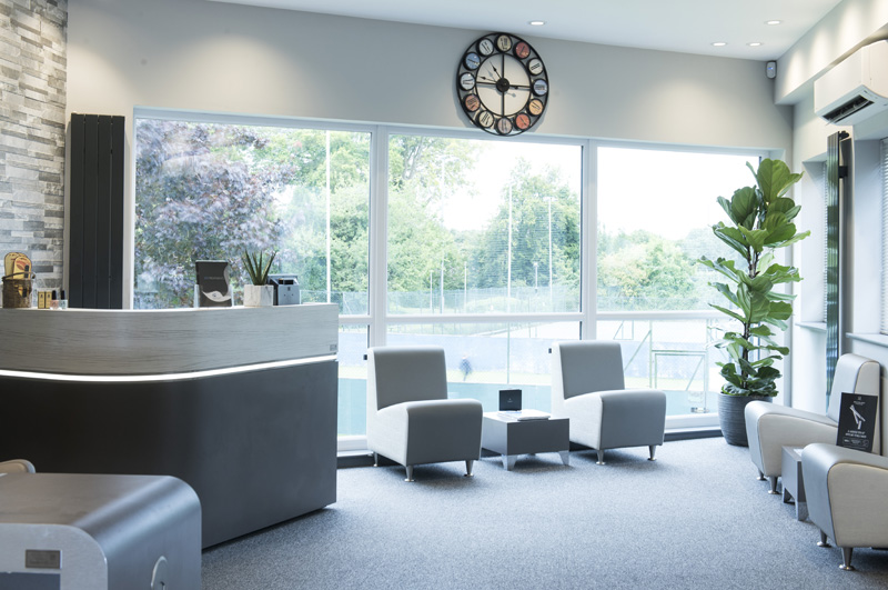 spa waiting area with desk and chairs