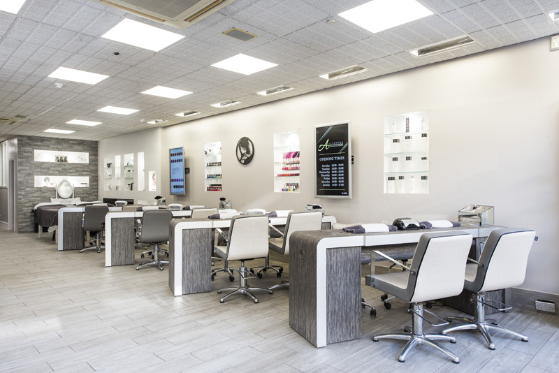 bright light nail salon with chairs and desks
