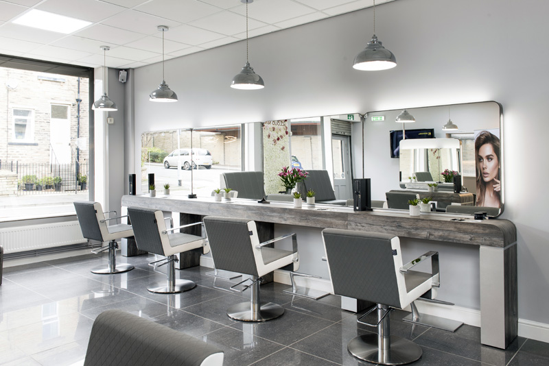 hair salon with modern furniture and big mirrors
