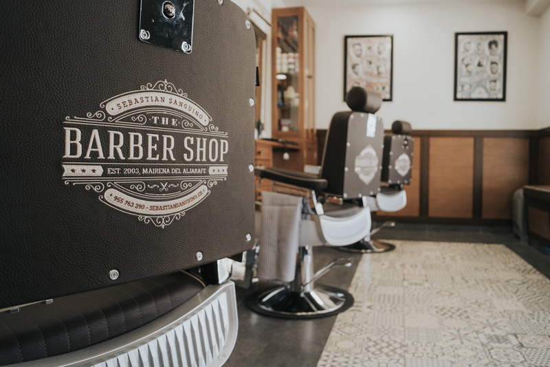 barbers shop with black barbers chairs