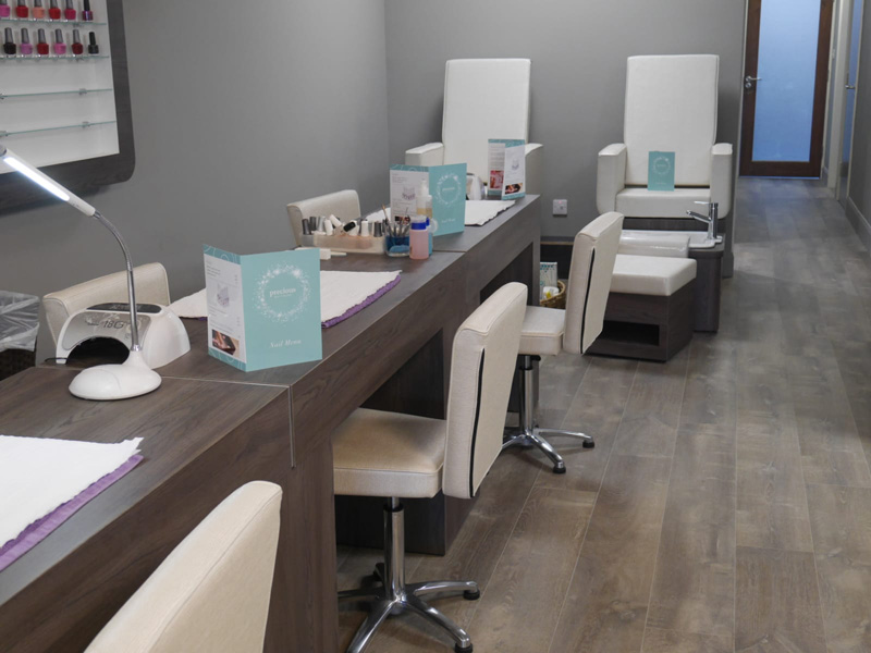 manicure table station with white leather chairs
