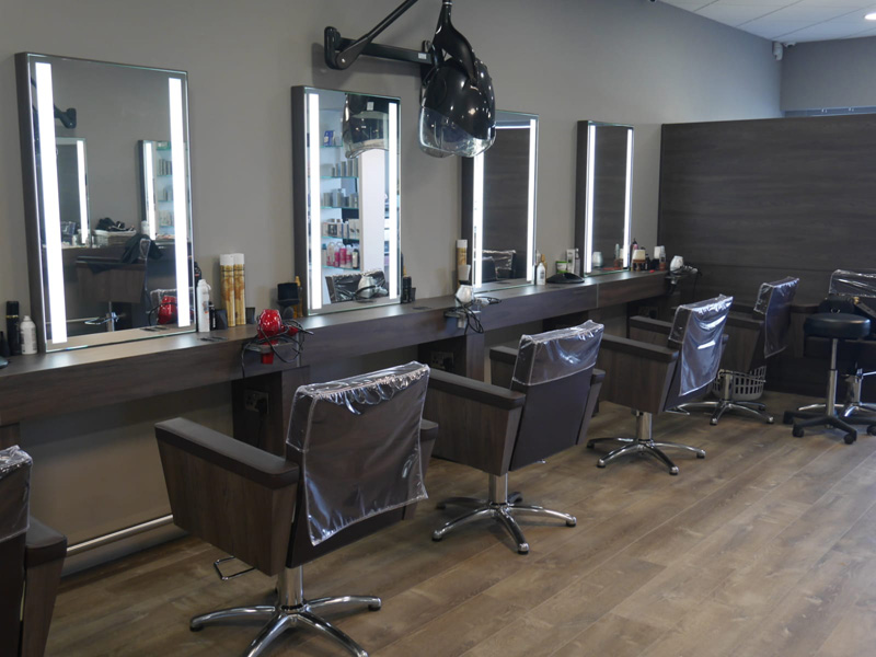 hair salon room with salon chairs and mirrors